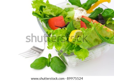 Healthy vegetarian Salad with tomatoes and lettuce over white