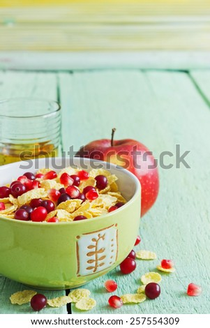 healthy vitamin breakfast of fruit, juice and corn flakes for children.  children food concept.selective focus - stock photo