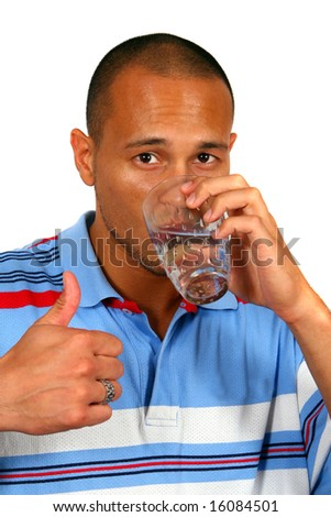 Healthy Water A young man drinking water out of a glass. He shows the thumb up sign. Isolated over white. - stock photo