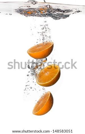 Healthy Water with Three Fresh Oranges. Splash isolated on white - stock photo