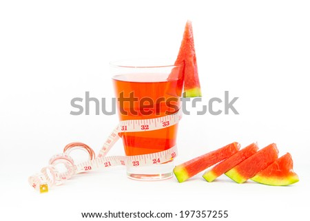 Healthy watermelon juice with tape measure on a white background. - stock photo
