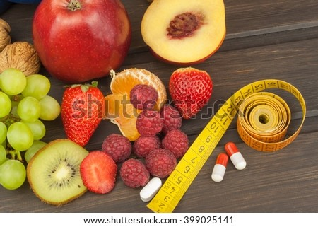 Healthy weight loss. Fruit, vitamins and sport. The concept of dietary supplements. - stock photo