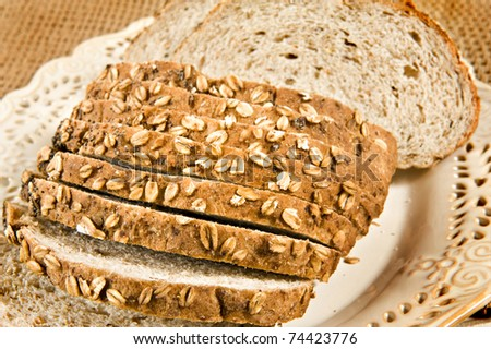 Healthy whole wheat bread in slices - close up - stock photo