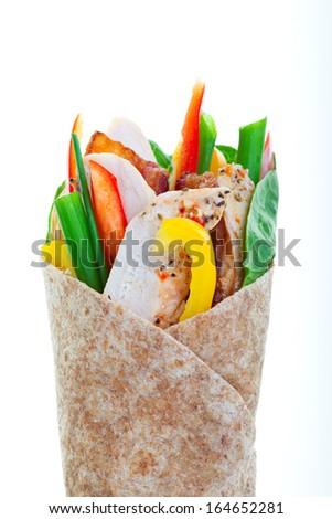 Healthy whole wheat turkey wrap on a white background. - stock photo