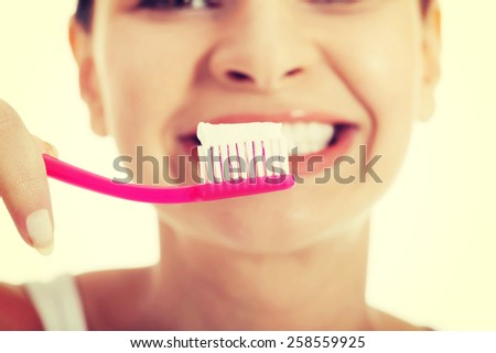 Healthy woman brushing her teeth. - stock photo