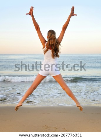 Healthy woman doing exercising on the beach, girl doing sport outdoor, health care concept - stock photo