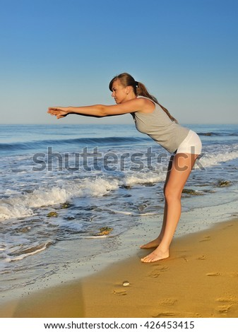 Healthy woman doing exercising on the beach, girl doing sport outdoor, health care concept