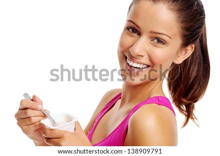 Healthy woman eating yoghurt isolated on white - stock photo