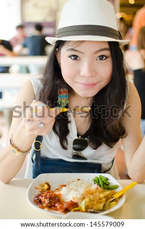 Healthy woman enjoy eating food on the table in restaurant - stock photo