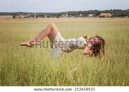 healthy woman floating in nature meadow, spa concept - stock photo