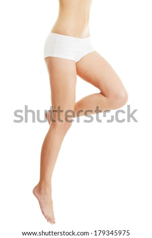 Healthy woman legs isolated on white - stock photo
