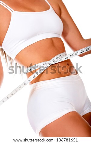 Healthy woman loosing weight - isolated over a white background - stock photo