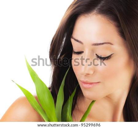 Healthy woman relaxing at spa, sensual female portrait with green fresh leaves, young lady with spring plant, girl isolated on white background, skin care concept - stock photo