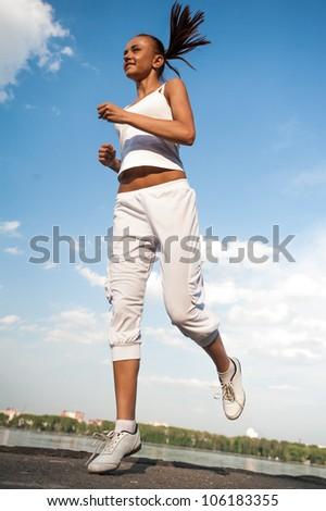 Healthy woman running - stock photo