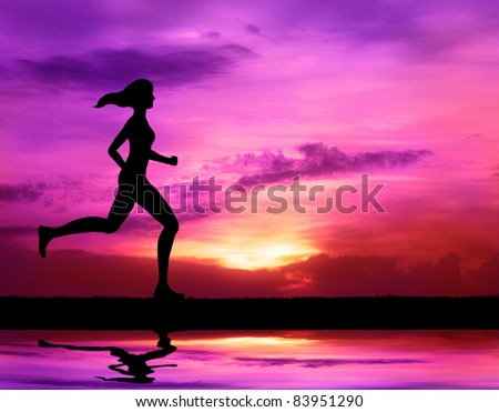 healthy woman running at sunrise silhouetted - stock photo