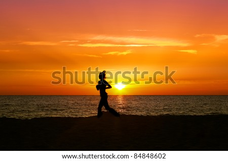 Healthy woman running during sunset - stock photo