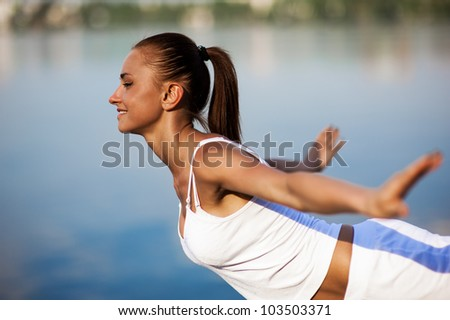 Healthy woman running on the beach - stock photo