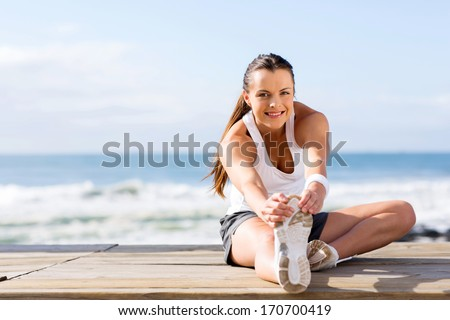 healthy woman stretching before fitness exercise - stock photo