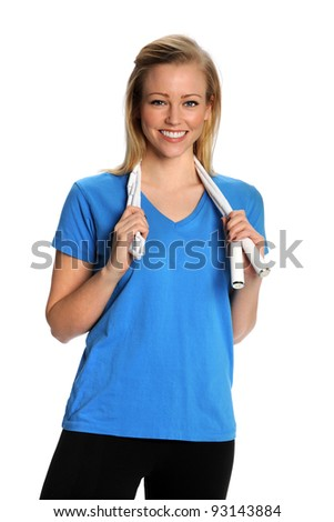 Healthy woman with jump rope around shoulders - stock photo