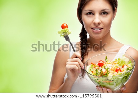 healthy woman with salad on green background