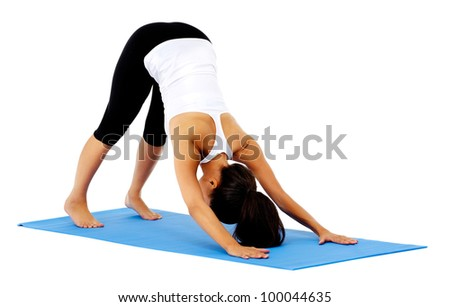 healthy yoga stretching woman does a downward facing dog. This is part of a series of various yoga poses by this model, isolated on white