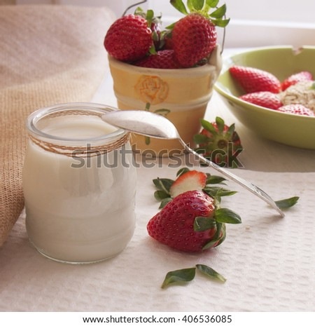 Healthy  yogurt and fresh strawberry berries