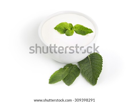 Healthy yogurt with mint leaves isolated on white background with shadow