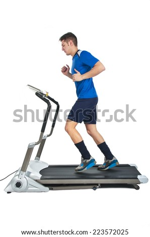 Healthy Young Caucasian Running, in Treadmill on white background - stock photo