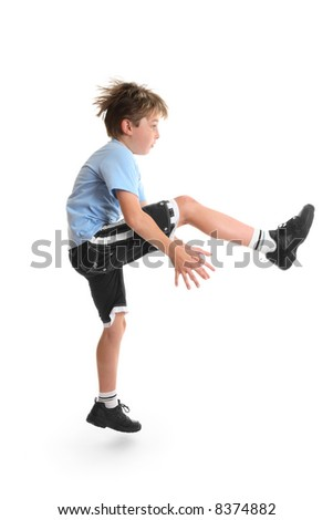 Healthy young child doing fitness exercises.