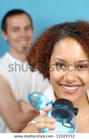 Healthy young couple working out at the gym - stock photo