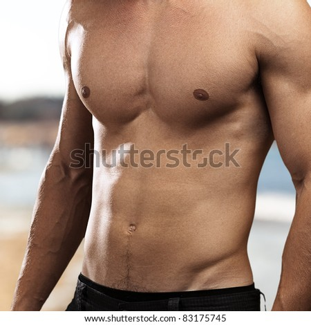 healthy young man against a beach background - stock photo