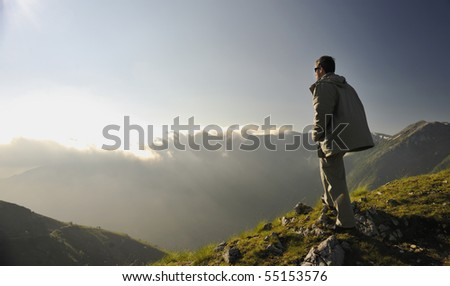 healthy young man practice youga in height mountain at early morning and sunrise - stock photo