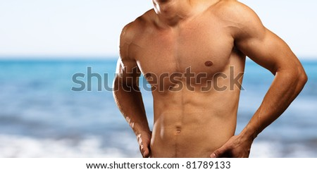 healthy young man with a beach as a background