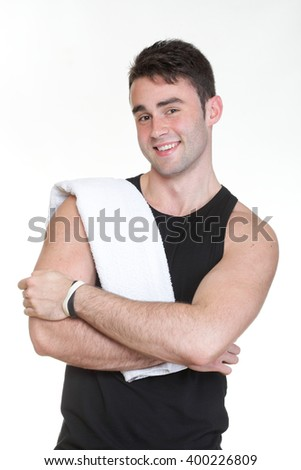 Healthy young man with towel isolated on white background