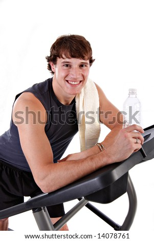 Healthy Young Man Workout on Treadmill Isolated - stock photo