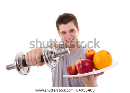 healthy young men exercise and hold fruits - stock photo