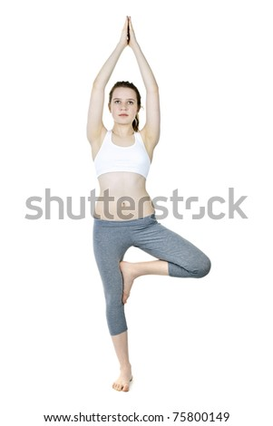 Healthy young woman doing tree yoga pose isolated on white - stock photo