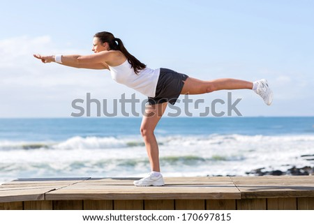 healthy young woman doing yoga stretch - stock photo