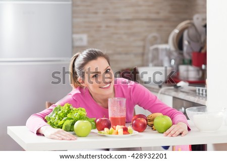 Healthy young woman enjoying in healthy food. - stock photo