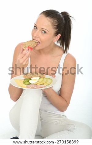 Healthy Young Woman Holding a Plate of a Typical Low Fat Norwegian or Scandinavian Style Breakfast - stock photo