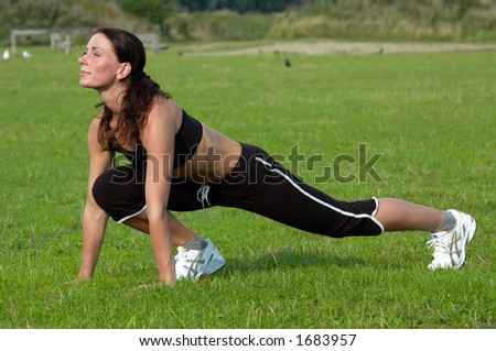 healthy young woman is doing a workout in the park
