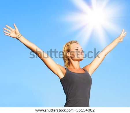 Healthy Young Woman over blue Sky - stock photo