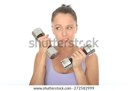 Healthy Young Woman Training With Dumb Bell Weights Looking Fed Up - stock photo