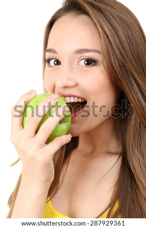 Healthy young woman with green apple isolated on white