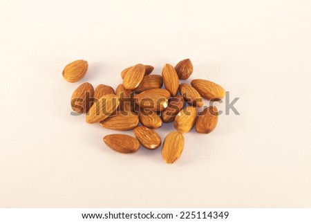 Healty, brown almonds, on isolated, white background - stock photo