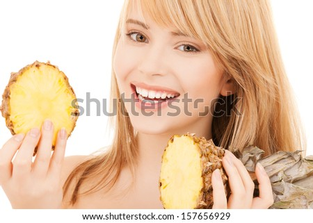 healty food and nutrition concept - happy girl with pineapple - stock photo