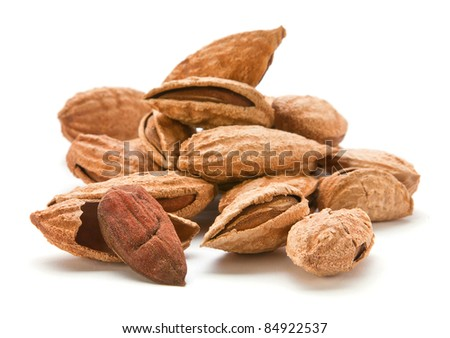 Heap almond nut closeup with shell on white - stock photo