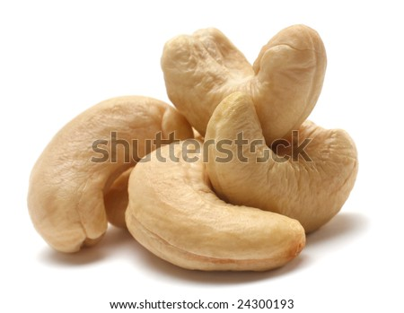 Heap cashew nut closeup with shadow on white - stock photo