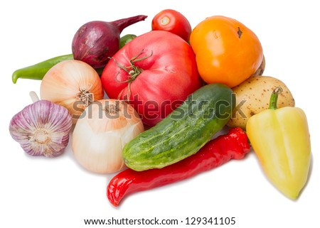 Heap fresh vegetables isolated on white background