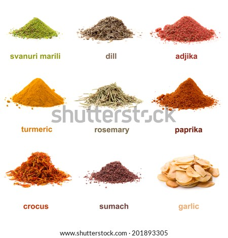 Heap ground Svanuri marili, dill seed, adjika, turmeric, rosemary, paprika, saffron, sumach and garlic isolated on white background - stock photo